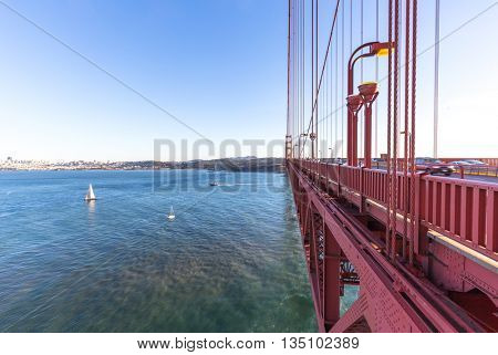 tranquil sea with sail boats with cityscape and skyline of san francisco on view from suspension