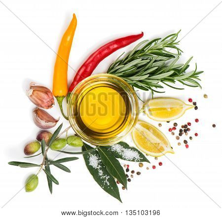 Top view of spices (chili peppers bay leaf rosemary garlic and mixture of peppers) and olive oil lemon isolated on a white background.