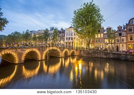 Charming houses by the canal in Amsterdam The Netherlands