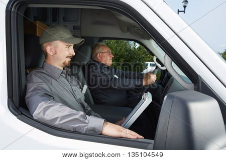 Group of delivery man in a car.