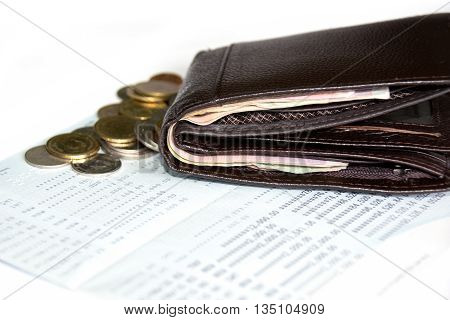Money in Wallet and coin on book bank