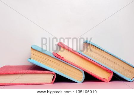 Stack Of Colorful Books, Grungy Blue Background, Free Copy Space. Education Essential For Self Impro