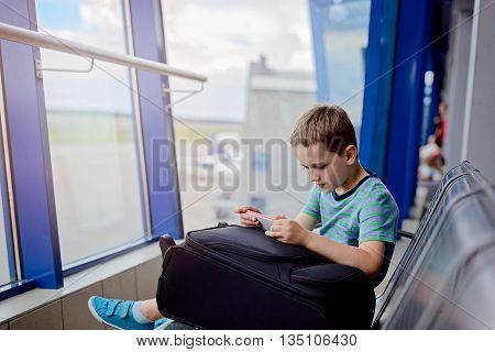 Bored 7 Years Old Boy Child Waiting For His Plane