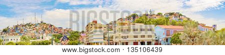 Guayaquil Ecuador - April 16 2016: View of picturesque colored poor houses at the top of a hill at Cerro Santa Ana in Guayaquil Ecuador