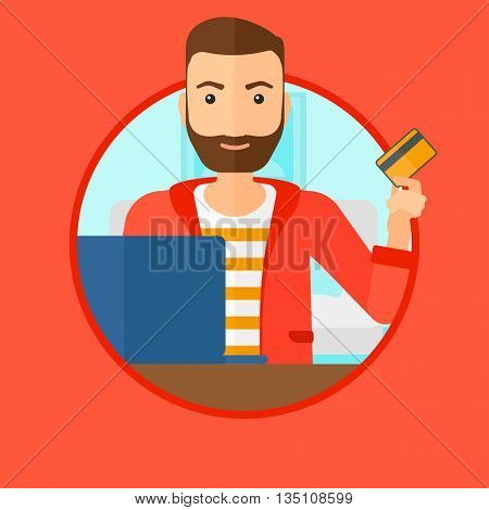 A hipster man with the beard holding a credit card and using laptop for online shopping. Young man shopping online at home. Vector flat design illustration in the circle isolated on background.
