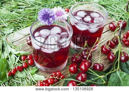 Cold refreshing berry drink with ice, drink of currant and cherry