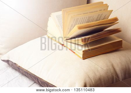 Open Book On A Pillow In Bed. Homeliness. Old Book. Seamless Texture Of Book Pages. Vintage Old Book