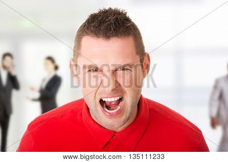 Young angry man screaming