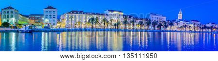 Waterfront cityscape panorama of touristic town of Split in blue hour, Croatia.