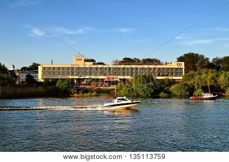 VELIKY NOVGOROD RUSSIA - MAY 29 2016. Facade of two-star Rossiya hotel at the bank of Volkhov river at summer evening architecture summer view