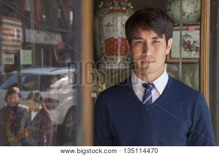 Asian son in front of store