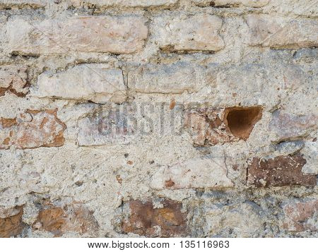 Old vintage red brick wall with sprinkled white plaster textured background