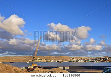 LUDERITZ NAMIBIA - JAN 26 2016: Luderitz port at sunset. Luderitz is a harbour town in southwest Namibia lying on one of the least hospitable coasts in Africa