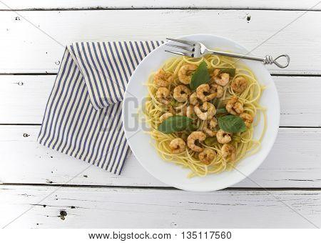 Chilli prawn linguine on retro white wooden table background