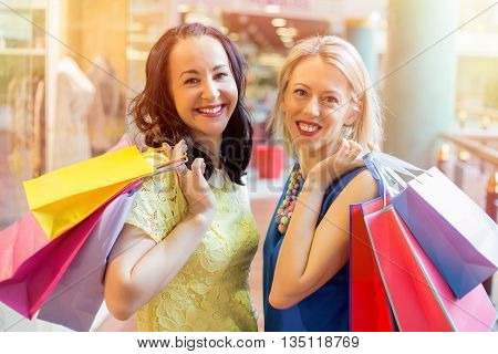 Two happy women at the shopping center