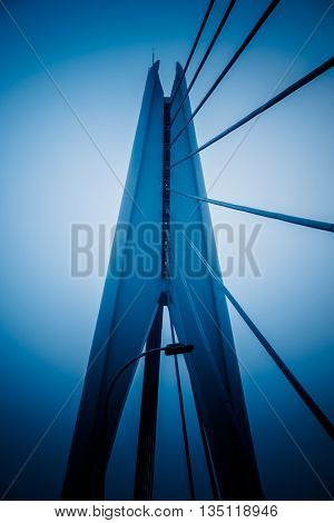 low angle view of bridge structure,blue toned image.