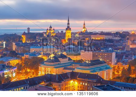 Aerial cityscape with Medieval Old Town illuminated at sunset with Saint Nicholas Church, Cathedral Church of Saint Mary and Alexander Nevsky Cathedral in Tallinn, Estonia