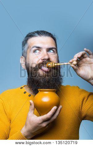 Bearded Smiling Man With Honey Jar