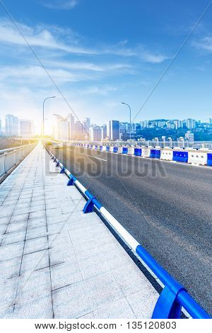clean highway,with cityscape background