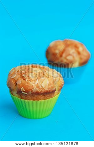 Muffins in silicone tins on a blue background