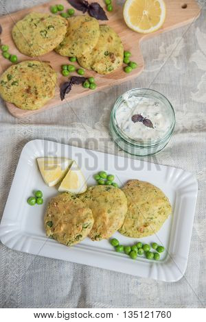 home made vegetarian patties with peas on a plate