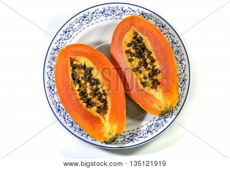 papaya in ceramic plate isolated on white