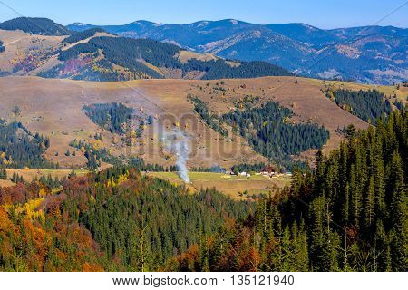 European Country Landscape of Mountains Forest and Village Autumn Season Colors