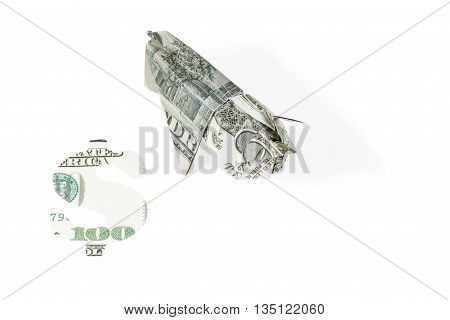 Pig origami folded from money and dollar sign carved out of hundred dollar bills isolated on white background