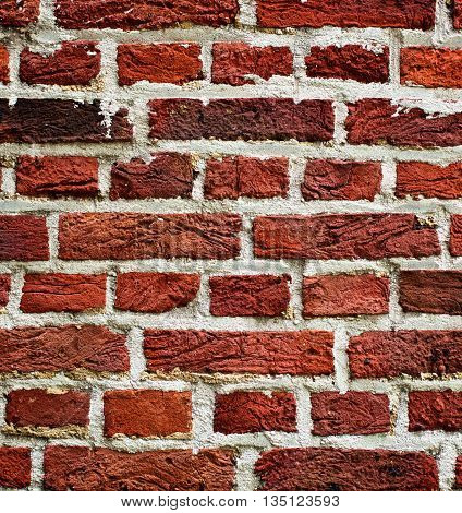 Background of Old Red Brick Wall with Cracked Concrete closeup Outdoors