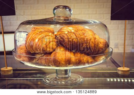 Сroissant In Glass Dessert Dish At Coffee Shop