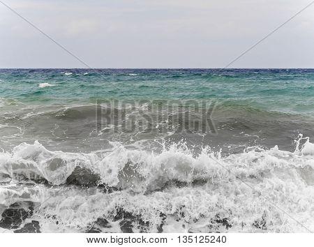 Big wild sea waves on the seashore