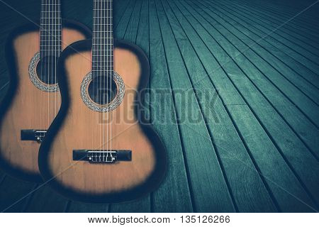 Part of a blue acoustic guitar on a wooden background