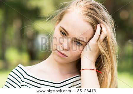 Close-up Of Thoughtful Girl In A Striped Dress