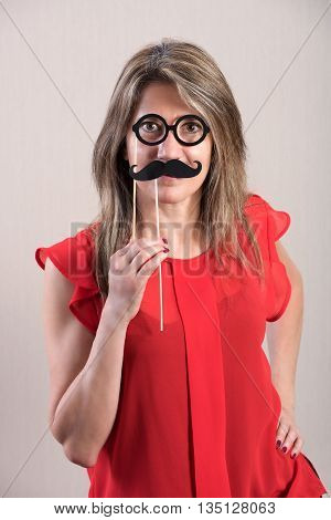 Attractive Woman Holding Funny Photo Booth Props
