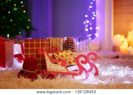 Christmas gift boxes and decoration on the soft carpet, indoor