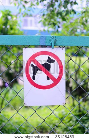 Sign prohibiting dog walking no dogs sing vertical location