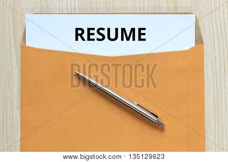 Top view of resume document in envelope on desk.