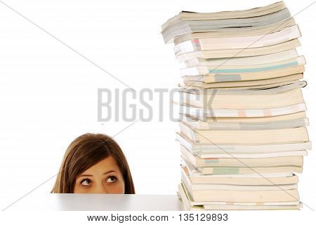 A girl under the stern gaze of a stack of book