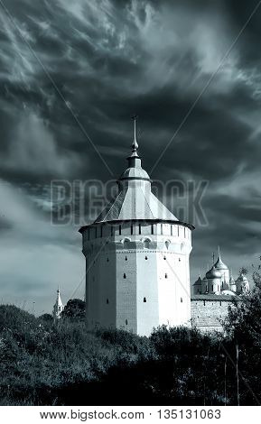 Watch tower of Spaso-Prilutsky Monastery in the Vologda city Russia. Dramatic view. Monochrome image. Castle defense wall