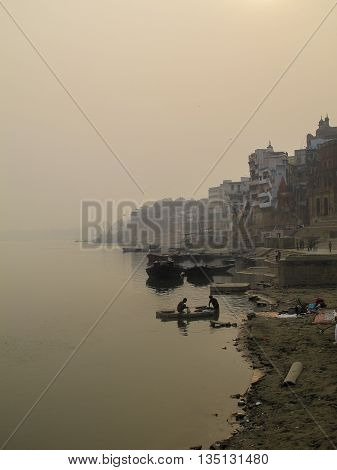 Ganges river and the ghats of Varanasi at sunset, India