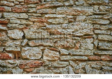 Old Weathered Stone Background. Wall of an Old Building