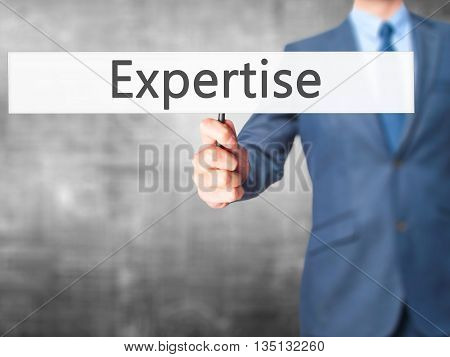 Expertise - Businessman Hand Holding Sign