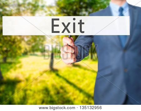 Exit - Businessman Hand Holding Sign
