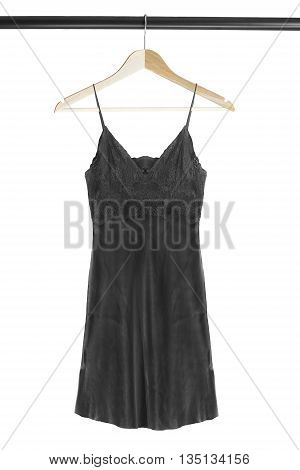 Black silk nightdress on wooden clothes rack isolated over white