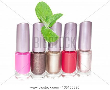 set of multi-colored nail polish isolated on white background