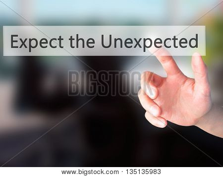 Expect The Unexpected - Hand Pressing A Button On Blurred Background Concept On Visual Screen.