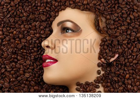 smiling woman profile face in coffee beans