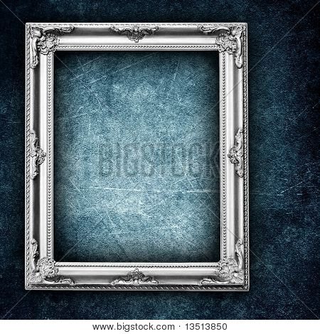 silver frame on grunge wall