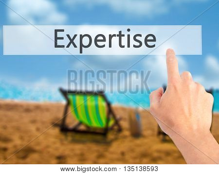 Expertise - Hand Pressing A Button On Blurred Background Concept On Visual Screen.
