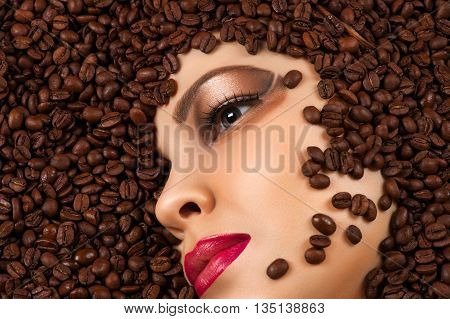 profile woman face in coffee beans closeup